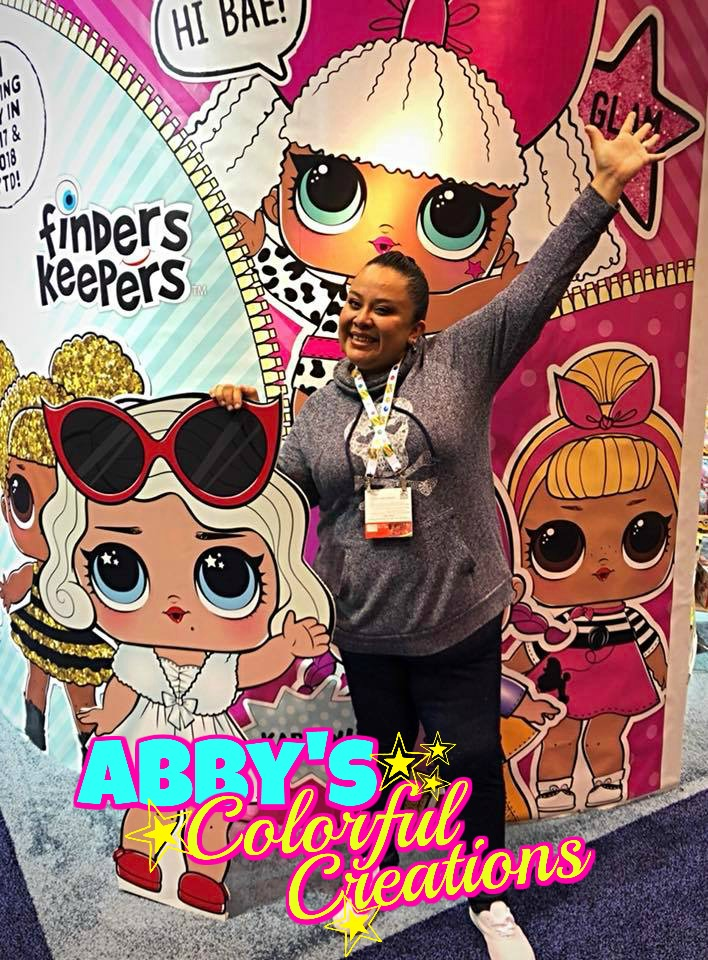 chicago_face_paint_abby_ascencio_girl_design_lol_dolls_pink_glitter_blue_bling_abbys_colorful_creations_lipstick_party_birthday_pose
