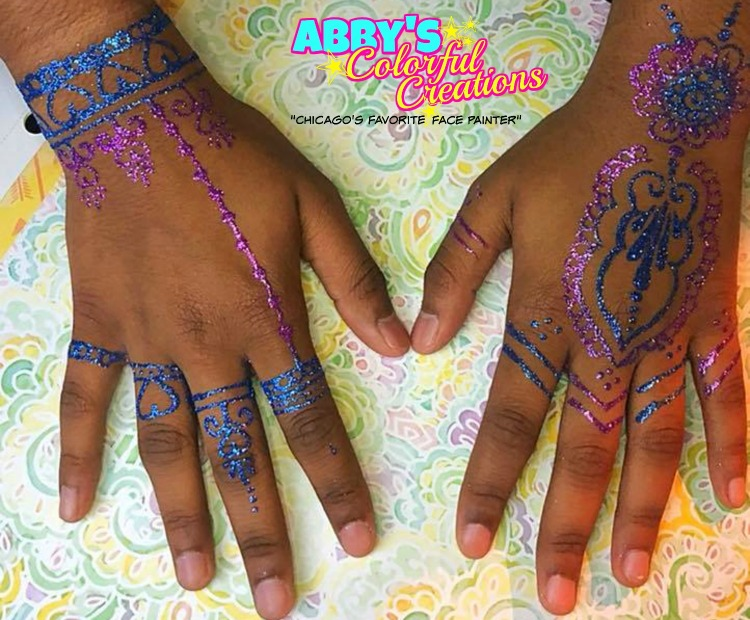 Free-hand_chicago_face_painter_abby_ascencio_free_hand_glitter_tattoo_hand_girl_rainbow_flowers_teen_girl_noth_hands_simple_fast_purple