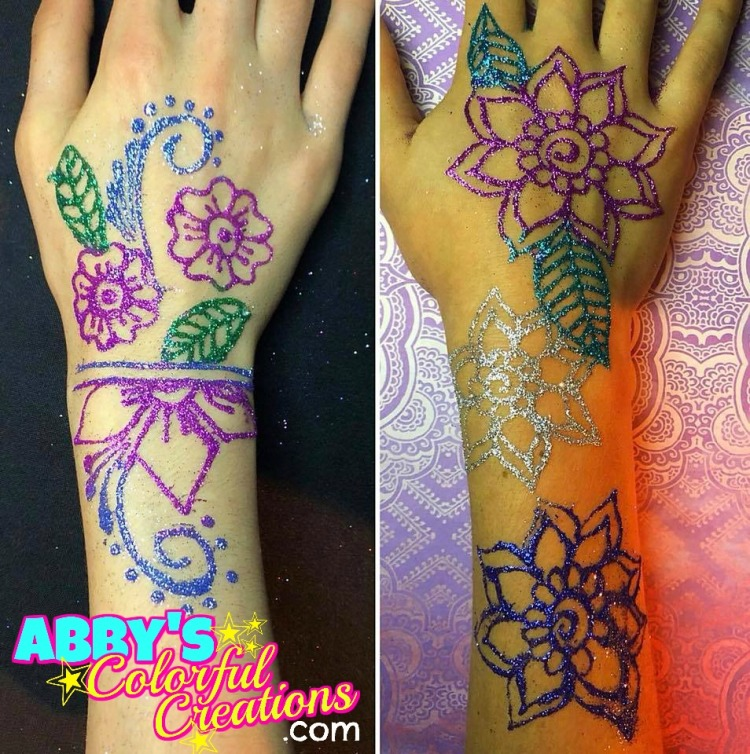 Free-hand_chicago_face_painter_abby_ascencio_free_hand_glitter_tattoo_hand_girl_rainbow_flowers_teen_girl_swirls_wrist_double_dots